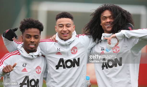 Angel Gomes Jesse Lingard and Tahith Chong of Manchester United in action during a training session at Aon Training Complex on March 08 2019 in...