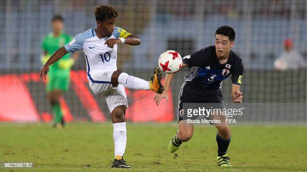 Angel Gomes of England battles for the ball with Yuki Kobayashi of Japan during the FIFA U17 World Cup India 2017 Round of 16 match between England...