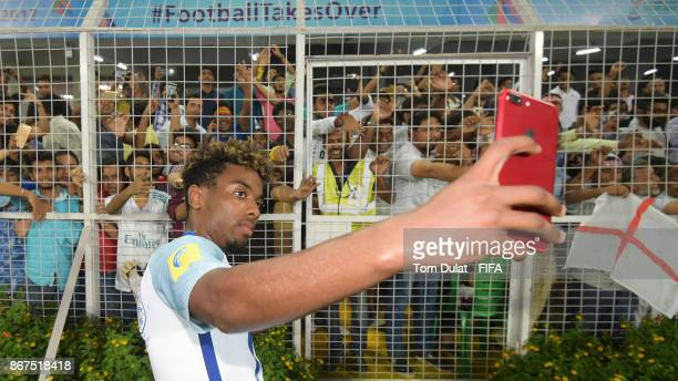 Angel Gomes of England celebrates with the fans after the FIFA U17 World Cup India 2017 Final match between England and Spain at Vivekananda Yuba...