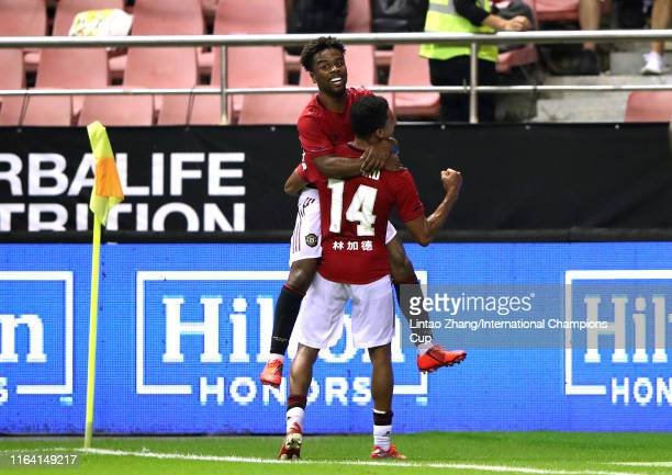 Angel Gomes of Manchester United celebrates scoring his side's second goal with his team mate Jesse Lingard during the International Champions Cup...