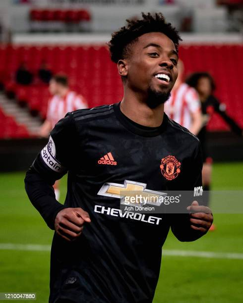Angel Gomes of Manchester United celebrates scoring their second goal during the Premier League 2 match between Stoke City U23s and Manchester United...