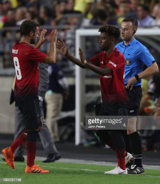 Angel Gomes of Manchester United comes on as a substitute for Juan Mata during the preseason friendly match between Manchester United and Club...