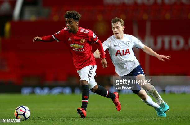 Angel Gomes of Manchester United controls the ball from Oliver Skipp of Tottenham Hotspur during the Premier League 2 match between Manchester United...
