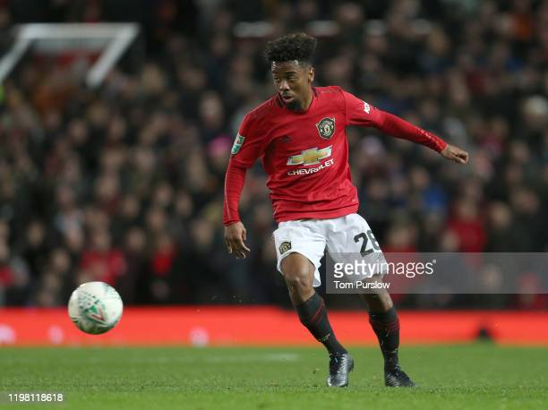 Angel Gomes of Manchester United in action during the Carabao Cup Semi Final match between Manchester United and Manchester City at Old Trafford on...