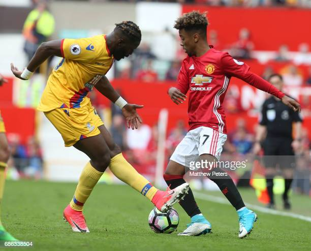 Angel Gomes of Manchester United in action with Bakary Sako of Crystal Palace during the Premier League match between Manchester United and Crystal...