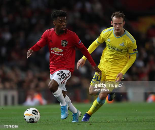Angel Gomes of Manchester United in action with Luka Simunovic of Astana during the UEFA Europa League group L match between Manchester United and FK...