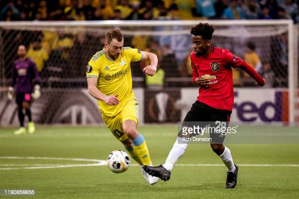 Angel Gomes of Manchester United in action with Runar Mar Sigurjonsson of FK Astana during the UEFA Europa League group L match between FK Astana and...