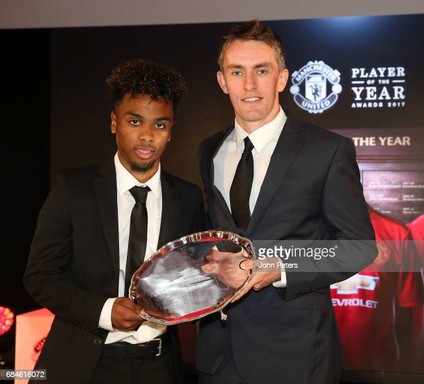 Angel Gomes of Manchester United is presented with the Jimmy Murphy Under18s Player of the Year award by U18s manager Kieran McKenna at the club's...
