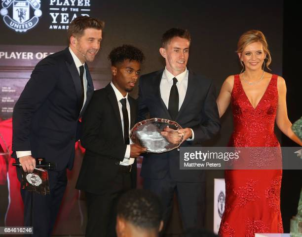 Angel Gomes of Manchester United is presented with the Jimmy Murphy Under18s Player of the Year award by U18s manager Kieran McKenna at the...