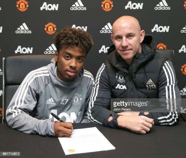 Angel Gomes of Manchester United signs his first professional contract with the club at Aon Training Complex on December 13 2017 in Manchester England