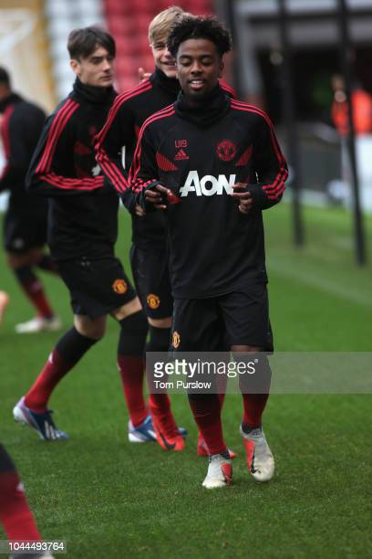 Angel Gomes of Manchester United U19s warms up ahead of the UEFA Youth League match between Manchester United U19s and Valencia U19s t Leigh Sports...