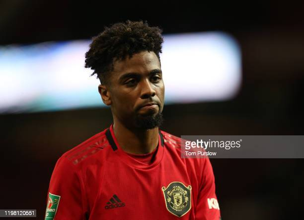 Angel Gomes of Manchester United walks off after the Carabao Cup Semi Final match between Manchester United and Manchester City at Old Trafford on...