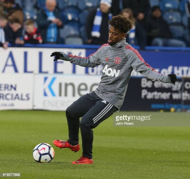 Angel Gomes of Manchester United warms up ahead of the Emirates FA Cup Fifth Round match between Huddersfield Town and Manchester United at Kirklees...