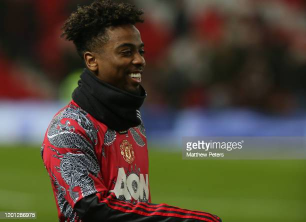 Angel Gomes of Manchester United warms up ahead of the Premier League match between Manchester United and Burnley FC at Old Trafford on January 22,...