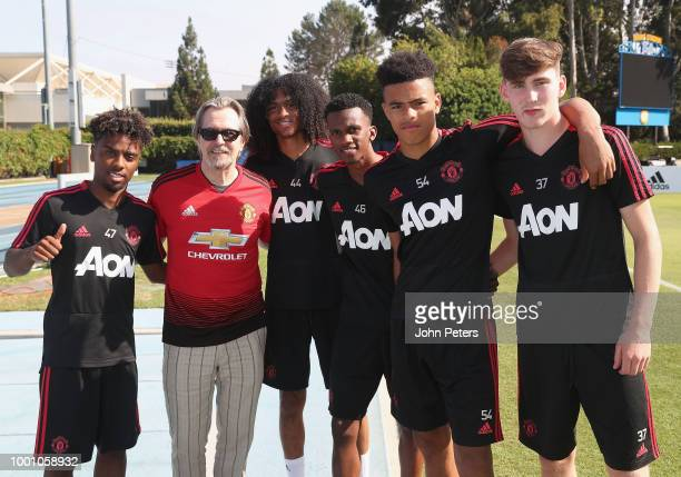 Angel Gomes Tahith Chong Joshua Bohui Mason Greenwood and James Garner of Manchester United pose with actor Gary Oldman after a first team training...