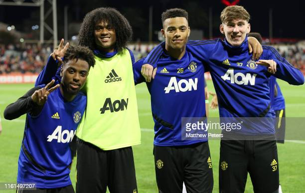 Angel Gomes Tahith Chong Mason Greenwood James Garner of Manchester United in action during an open training session as part of their preseason tour...