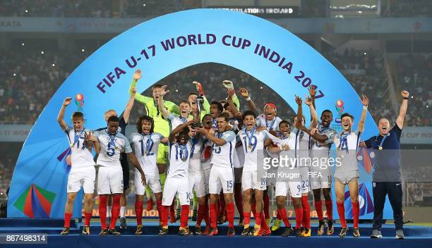 Angel Gomez and Joel Latibeaudiere of England lift the winners trophy during the FIFA U17 World Cup India 2017 Final match between England and Spain...