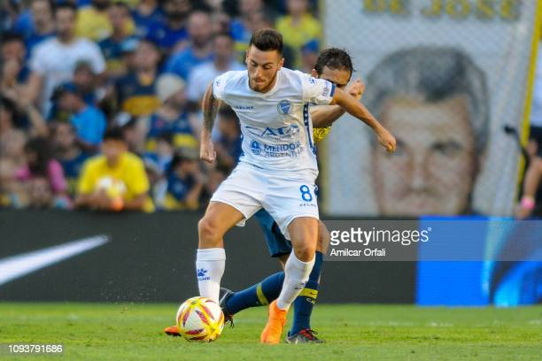 Angel Gonzalez of Godoy Cruz fights for the ball with Carlos Izquierdoz of Boca Juniors during a match between Boca Juniors and Godoy Cruz as part of...