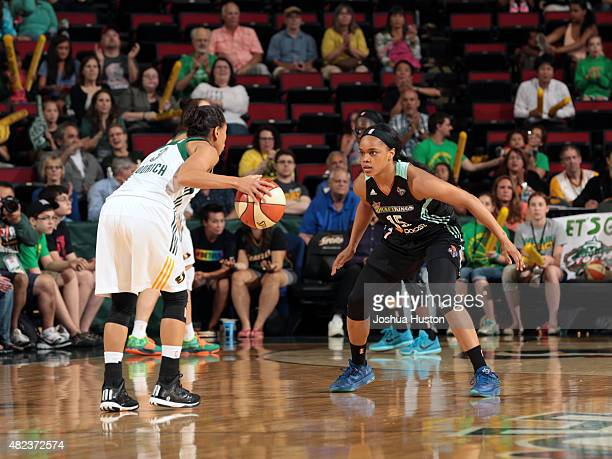 Angel Goodrich of the Seatte Storm dribbles the ball while defended by Brittany Boyd of the New York Liberty on July 21 2015 at Key Arena in Seattle...