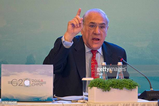 Angel Gurria SecretaryGeneral of OECD speaks on stage at the Highlevel Tax Symposium held in Chengdu in Southwestern China's Sichuan province...