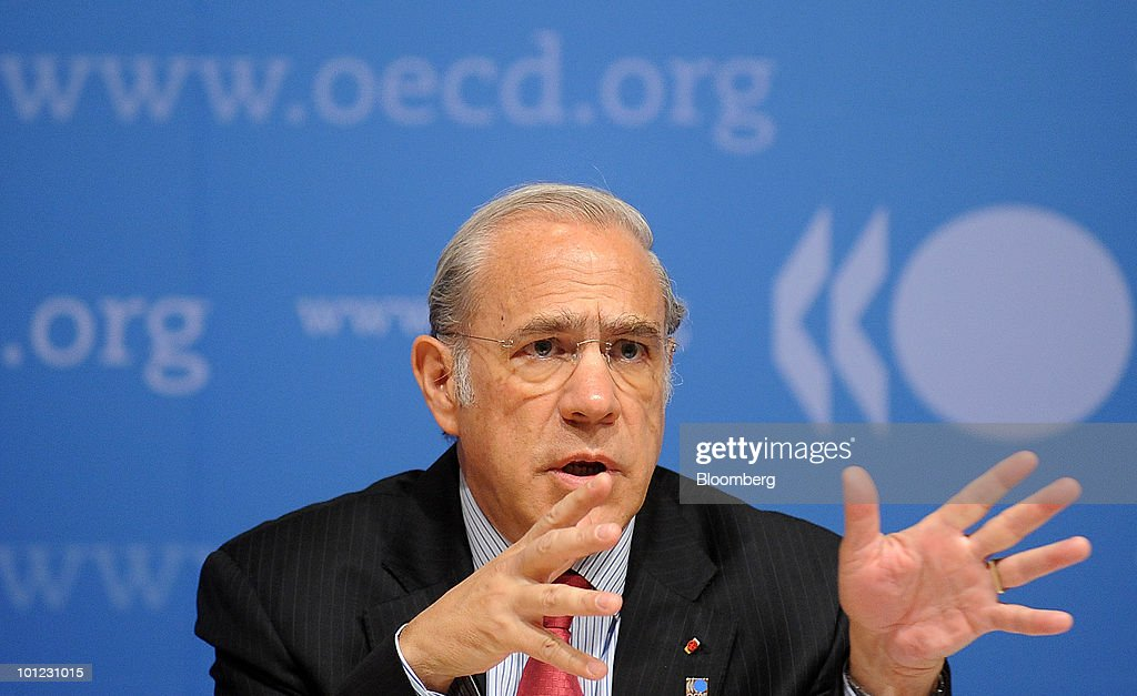 Angel Gurria, secretary-general of the Organisation of Economic Cooperation and Development (OECD), gestures while speaking at a news conference at the Organisation for Economic Cooperation and Development (OECD) headquarters in Paris, France, on Friday, May 28, 2010. Slovenia, along with Israel and Estonia, are joining the Paris-based organization of 31 of the world's most developed economies. Photographer: Antoine Antoniol/Bloomberg via Getty Images