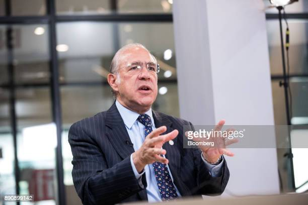 Angel Gurria secretarygeneral of the Organization for Economic Cooperation and Development gestures while speaking during a Bloomberg Television...