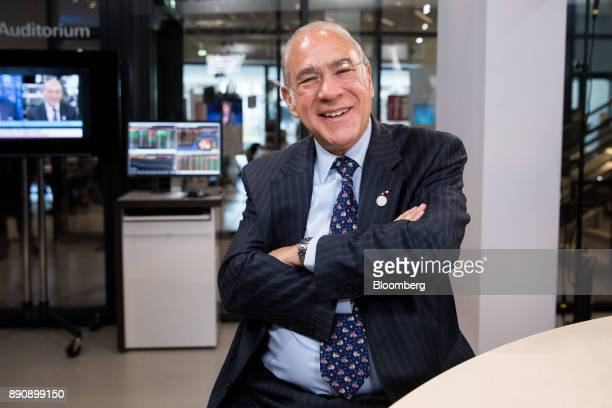 Angel Gurria secretarygeneral of the Organization for Economic Cooperation and Development poses for a photograph following a Bloomberg Television...