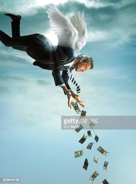 Angel in business suit dropping money from sky