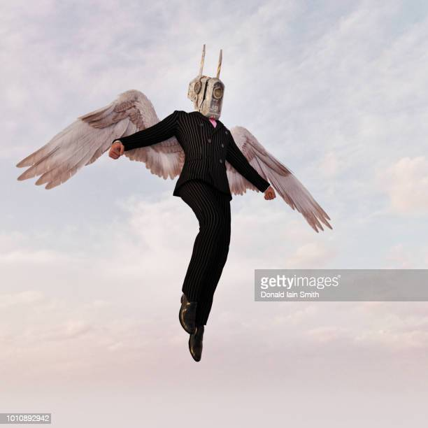 Angel Investor: Bizarre futuristic businessman with cyborg head and angel wings descends from the sky