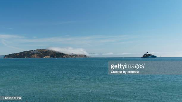 angel island and yacht - angel island stock photos and pictures