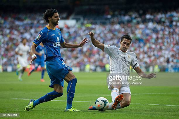 Angel Lafita of Getafe CF competes for the ball with Alvaro Arbeloa of Real Madrid CF during the La Liga match between Real Madrid CF and Getafe CF...