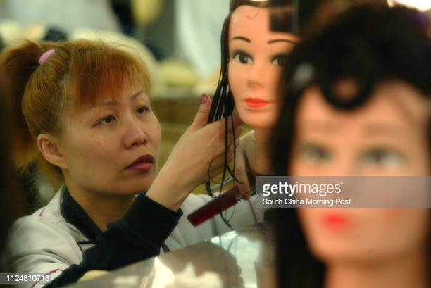 Angel Li Siufun studies haircut course at Caritas Cosmetic Career Center 24 March 2004