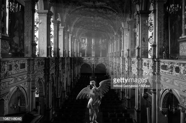 angel looking down at the chapel in the frederiksborg castle - frederiksborg castle stock pictures, royalty-free photos & images