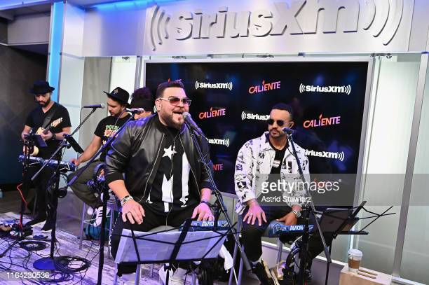 Angel Lopez and Jay Rodriguez perform with Tony Succar for the SiriusXM's Caliente Channel at the SiriusXM studios in New York City on July 25 2019...