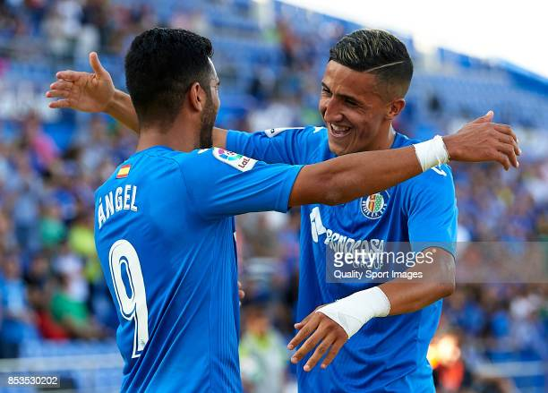 Angel Luis Rodriguez of Getafe celebrates scoring his team's fourth goal with his teammate Fayal Fajr during the La Liga match between Getafe and...