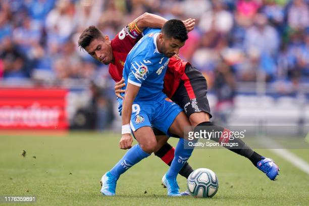 Angel Luis Rodriguez of Getafe CF battle for the ball with Pedraza of RCD Mallorca during the La Liga match between Getafe CF and RCD Mallorca at...