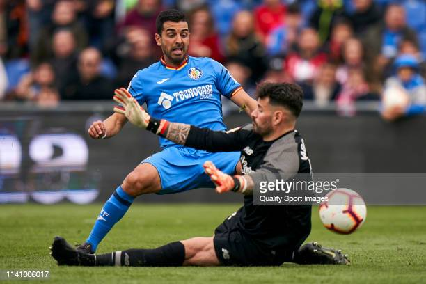 Angel Luis Rodriguez of Getafe CF scores the first goal to Iago Herrerin of Athletic Club during the La Liga match between Getafe CF and Athletic...