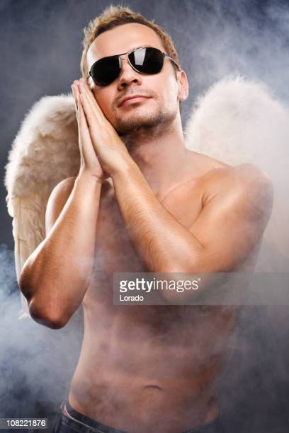 angel man with fog - male angel stock photos and pictures
