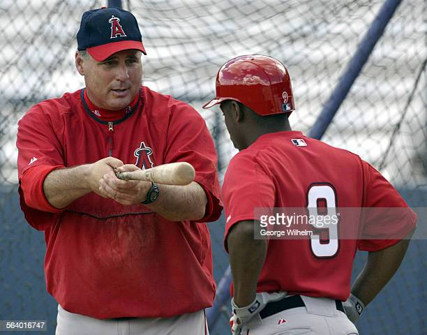 2/22/2005 – Angel manager Mike Sciosia gives some bunting tips to Chone Figgins during a spring training workout at the Los Angeles Angels of Anaheim...
