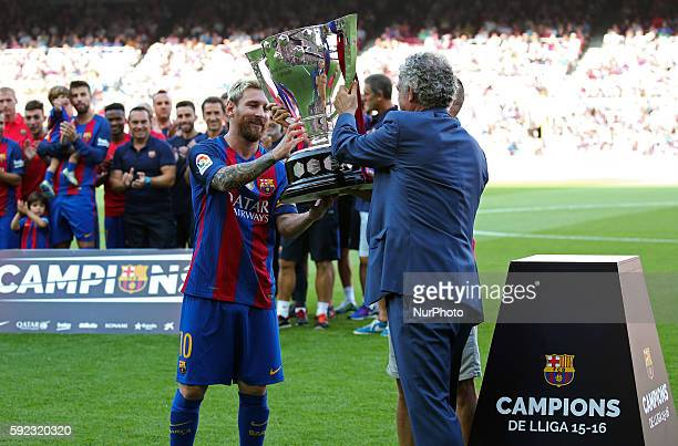 Angel Maria Villar delivery the trophy to the League 2015-16 to Leo Messi andAngel Maria Villar before the La Liga match between F.C. Barcelona v...