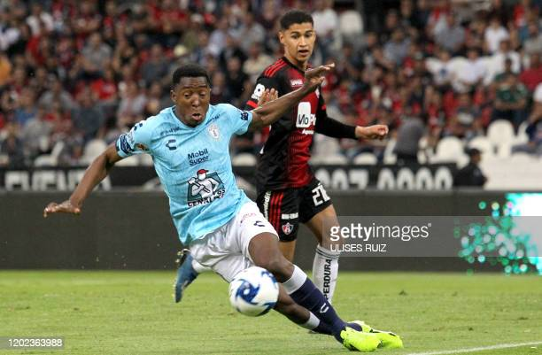 Angel Marquez of Atlas vies for the ball with Oscar Murillo of Pachuca during the Mexican Clausura 2020 tournament football match at Jalisco Stadium...