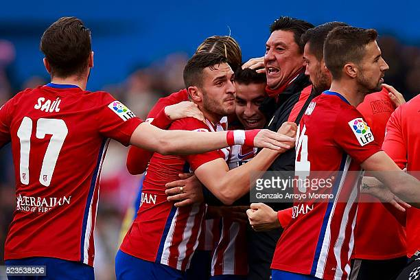 Angel Martin Correa of Atletico de Madrid celebrates scoring their opening goal with assistant coach German Burgos and teammates during the La Liga...