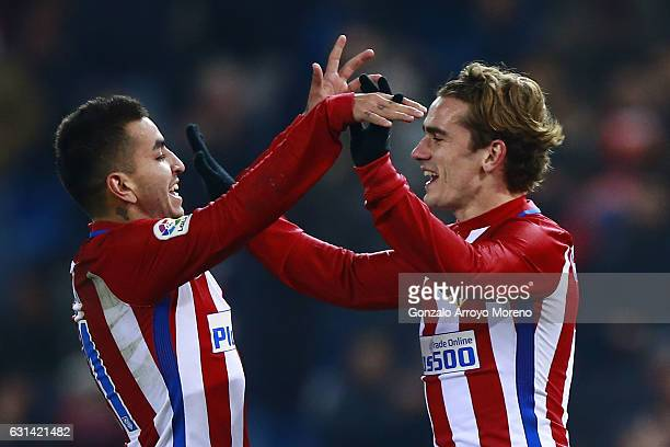Angel Martin Correa of Atletico de Madrid celebrates scoring their second goal with teammate Antoine Griezmann during the Copa del Rey Round of 16...