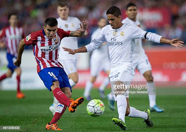 Angel Martin Correa of Atletico de Madrid competes for the ball with Raphael Varane of Real Madrid CF during the La Liga match between Club Atletico...