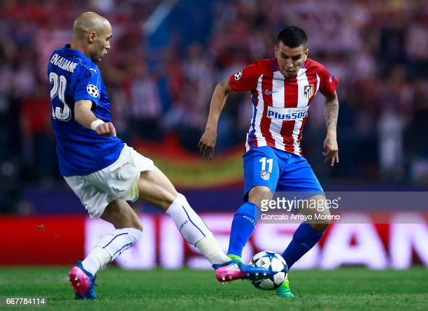 Angel Martin Correa of Atletico de Madrid competes for the ball with Yohan Benalouane of Leicester City FC during the UEFA Champions League Quarter...