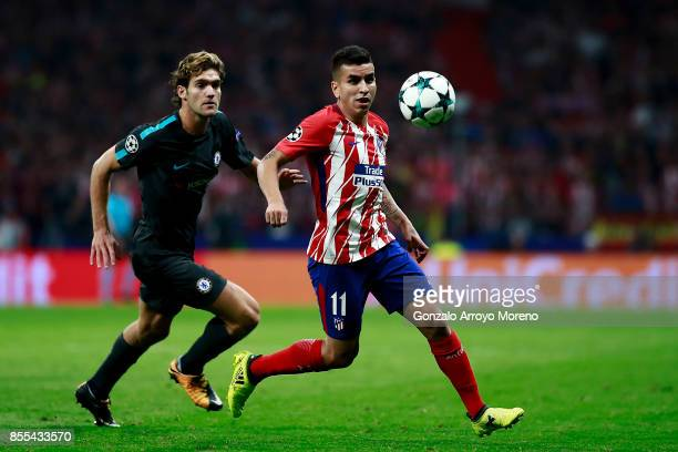 Angel Martin Correa of Atletico de Madrid runs for the ball ahead Marcos Alonso of Chelsea FC during the UEFA Champions League group C match between...