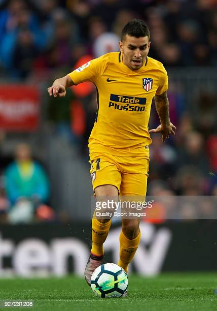 Angel Martin Correa of Atletico de Madrid runs with the ball during the La Liga match between FC Barcelona and Atletico de Madrid at Camp Nou on...