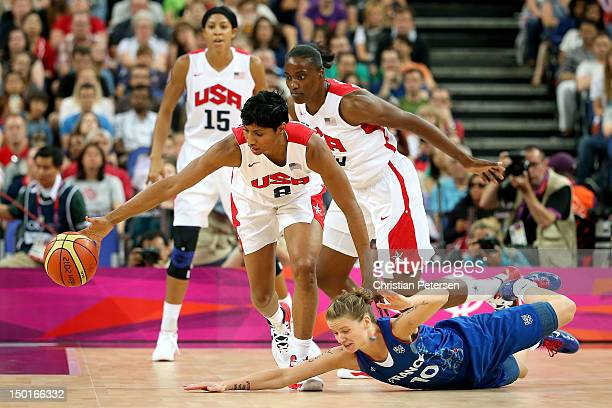 Angel McCaughtry of the United States moves the ball against a diving Florence Lepron of France in the second quarter during the Women's Basketball...