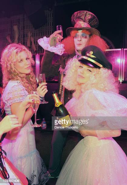 Angel McCord John Lewis and AnnaLynne McCord attend Veuve Clicquot's Yelloween at Lavo Las Vegas at the Palazzo on October 30 2010 in Las Vegas Nevada