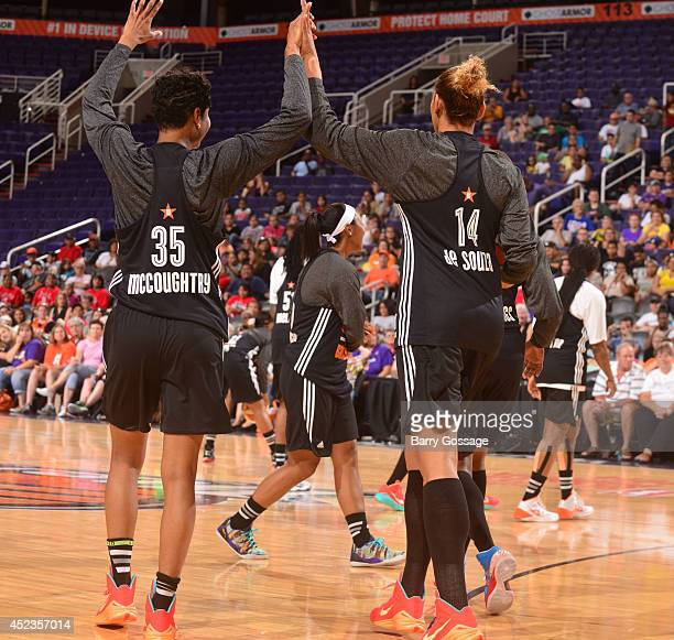 Angel McCoughtry and Erika de Souza of the Eastern Conference high five each other during AllStar Practice and Media Availability on July 18 2014 at...